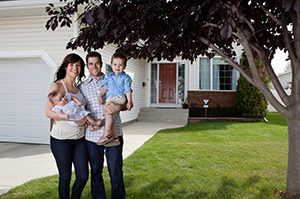 Family in front of a home.
